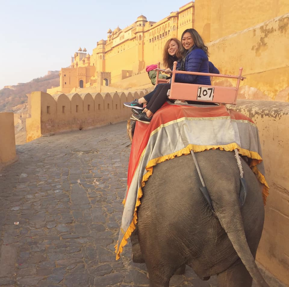 Janet Armitage (left) and Janny Li (right) on a sunrise elephant ride to Amber Fort in Jaipur.
