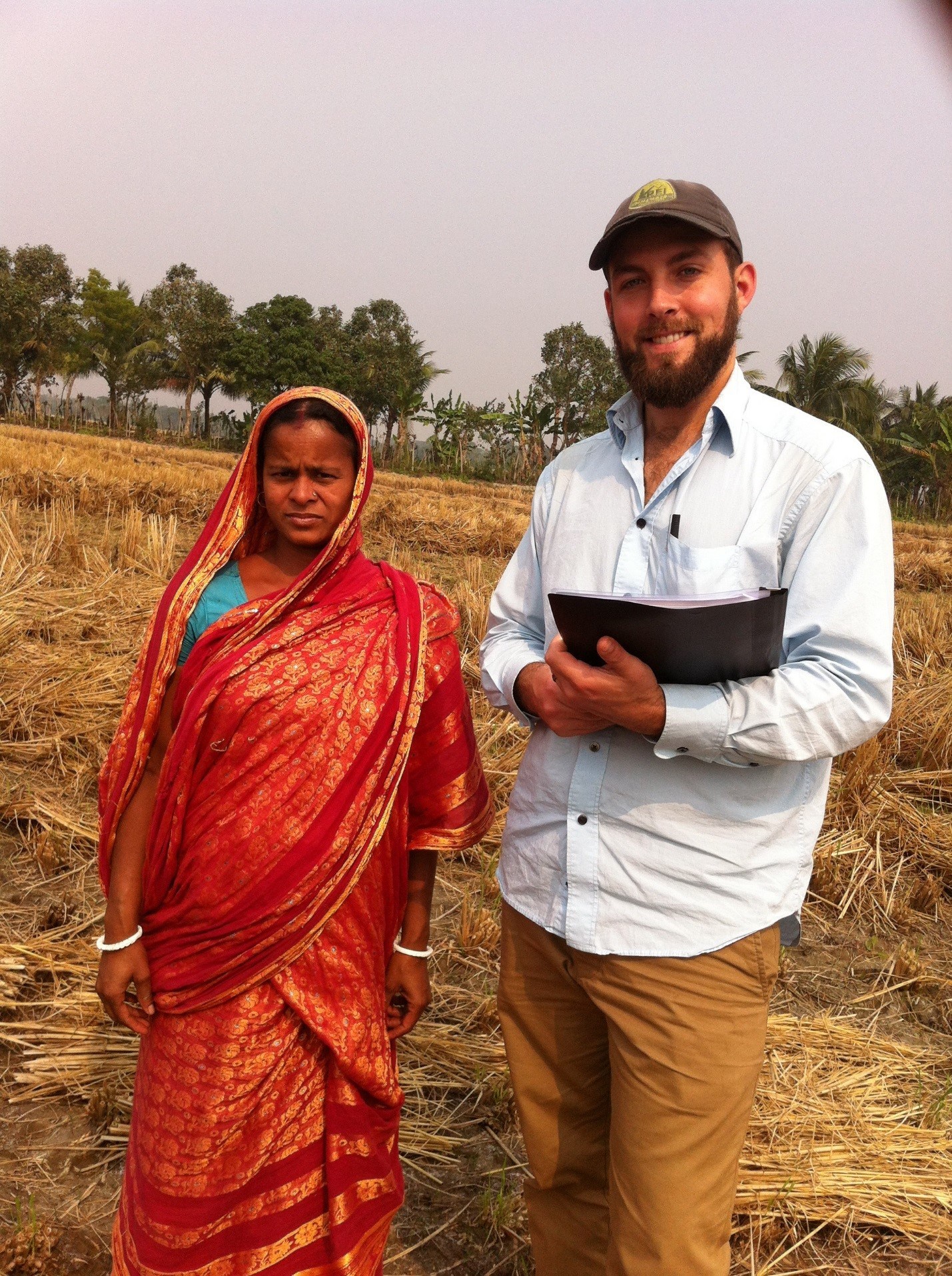 Aaron shew in a field with research subject
