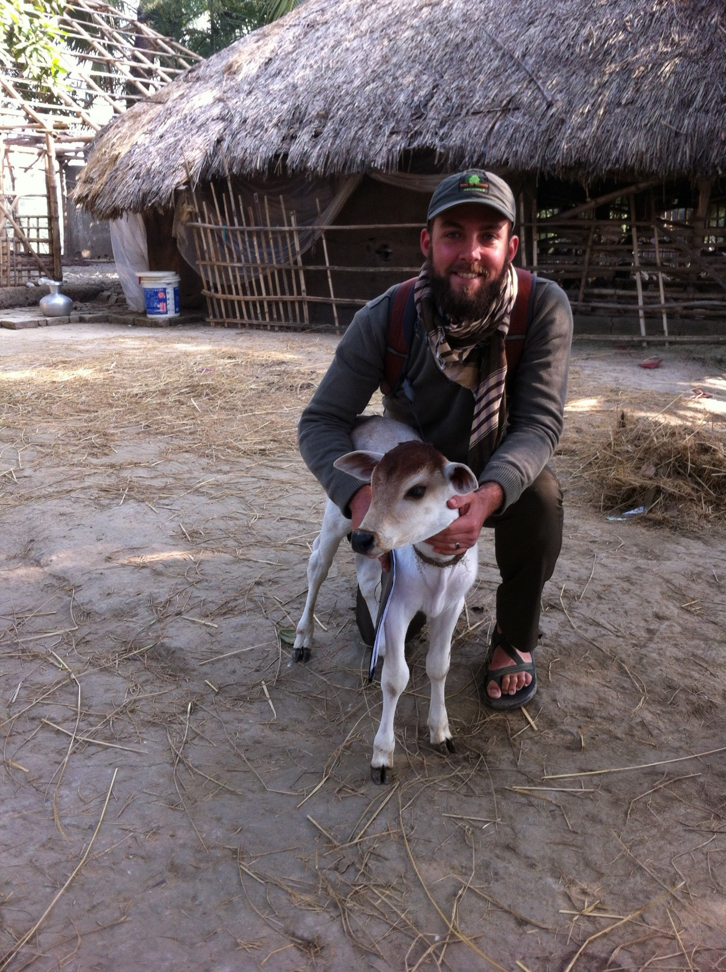 Aaron Shew outside with calf